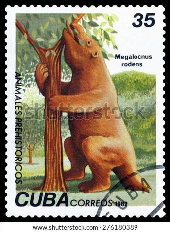 CUBA- CIRCA 1982: A stamp printed in , shows Megalocnus rodens, Prehistoric Fauna, circa 1982 - stock photo