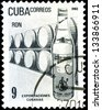 """CUBA - CIRCA 1982: a stamp printed in the Cuba shows Cuban export products: Rum, with inscription and name of series """"Cuban Export"""", circa 1982 - stock"""