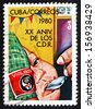 CUBA - CIRCA 1980: a stamp printed in the Cuba shows Feeding Babies, 20th Anniversary of Revolutionary Defense Committees, circa 1980 - stock photo