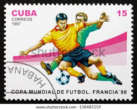 CUBA - CIRCA 1997: a stamp printed in the Cuba shows Soccer Players in Action, 1982 World Cup Soccer Championships, France, circa 1997 - stock photo