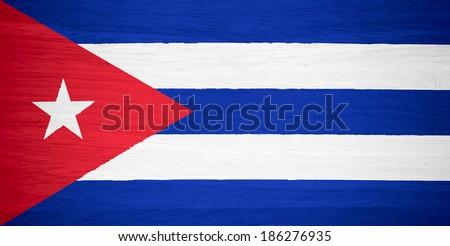 Cuba flag on wood texture - stock photo