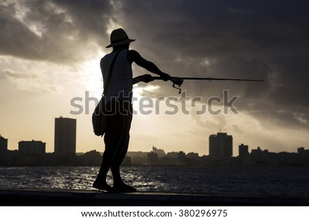 Cuba, Havana, Angler in the Malecon at sunset