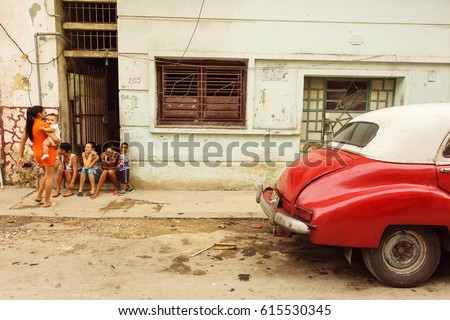 Cuba, Havana - 17 February 2017: Unknown people relaxing on beautiful colorful streets of Havana. Editorial picture.