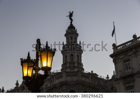 Cuba, Havana, Street lamp and historic building in the background - stock photo