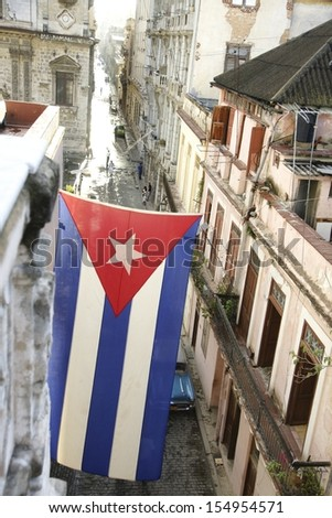 Cuba, Havana streets, flag - stock photo