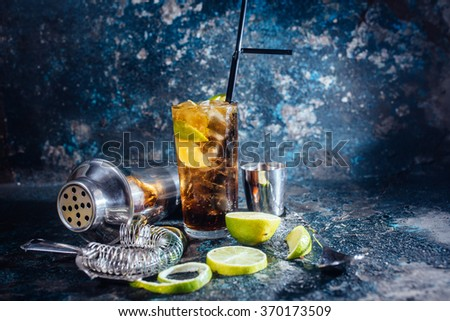 Cuba libre drink, alcoholic beverage with lime and ice served in restaurant and pub - stock photo