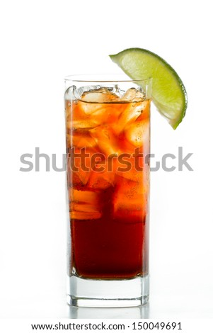cuba libre, rum and cola cocktail served in a tall glass with a lime garnish isolated on a black background