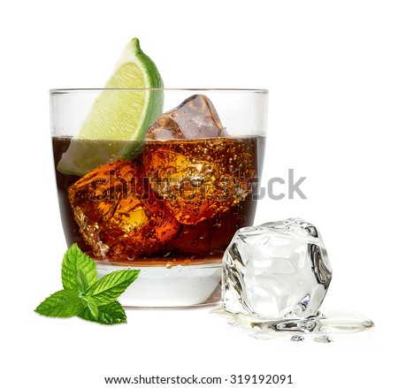 Cuba libre rum cocktail with ice cubes and lime wedge isolated on white background - stock photo