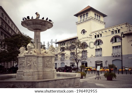 Cuba. Old Havana. Sierra Maestra Havana and fountain of lions on San Francisco Square,with a retro effect - stock photo