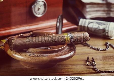 cuban cigars on table - stock photo