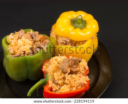 Cuban Cuisine: Bell Peppers Stuffed with Yellow Rice and pork meat. Creative presentation of a popular dish for dinner or lunch in the Caribbean Island - stock photo