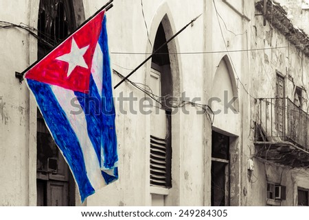 Cuban flag on a grunge decaying neighborhood - stock photo