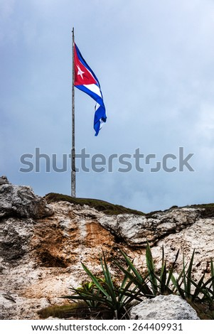 Cuban national flag on a stone hill - stock photo