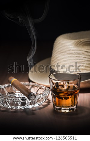 Cuban style rum and cigar close up - stock photo