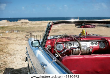 cuban vintage car parked on the seacost in havana - stock photo