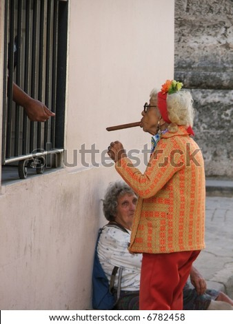 Cuban woman asking for light a cigar - stock photo