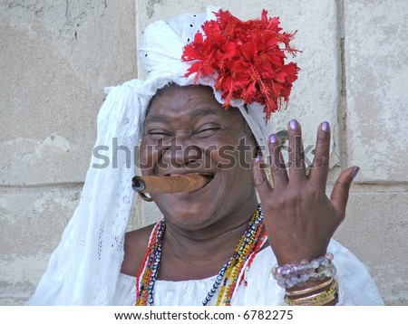 Cuban woman smoking cigar on streets year 2006 - stock photo