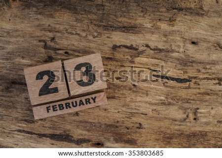 cube calendar for february on wooden surface with copy space - stock photo