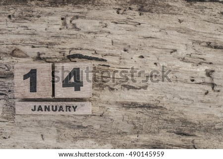 Cube calendar for january on wooden background with copy space