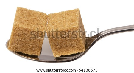 cube of brown sugar on spoon, isolated on white