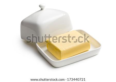 cube of butter in ceramic jar - stock photo