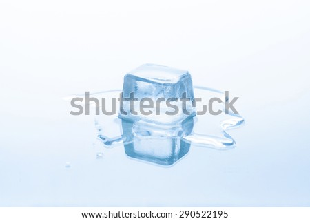 Cube of frozen ice is melting isolated on white background - stock photo