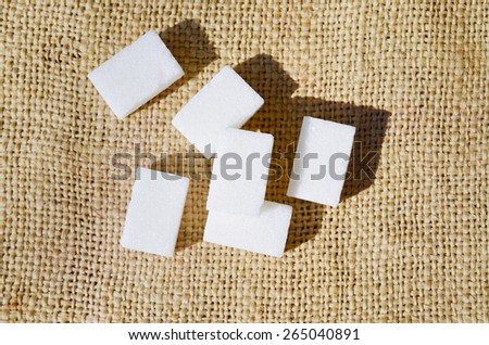 Cube of sugar with canvas background - stock photo