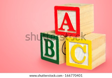 Cube pyramide on pink background  - stock photo