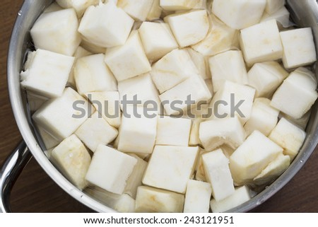 Cubed Celeriac in pot ready for boiling. - stock photo