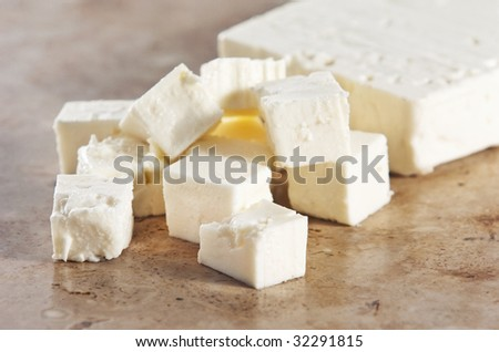 Cubed feta cheese on a kitchen counter - stock photo