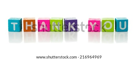 Cubes each with a letter on it written the word thank you - stock photo