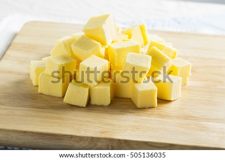 Cubes of butter on cutting board, horizontal