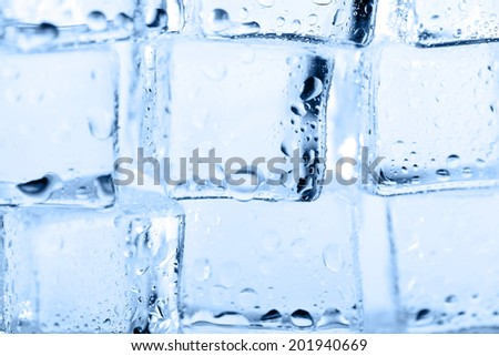 cubes of clear transparent ice close up - stock photo
