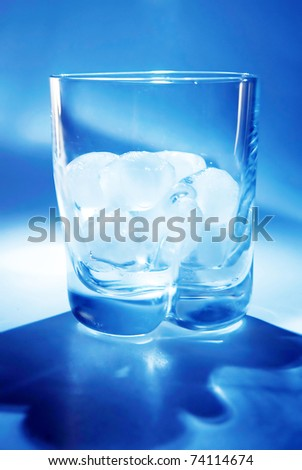 cubes of ice on the blue background - stock photo