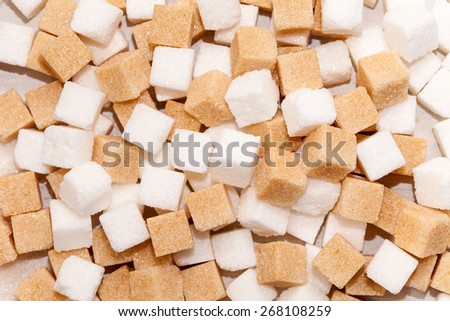 Cubes of sugar cane brown and white refined background - stock photo