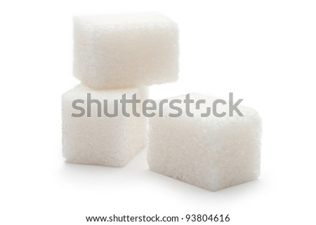 Cubes of sugar on the white background - stock photo