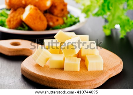 Cubes of yellow cheese .