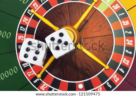 cubes on roulette background - stock photo
