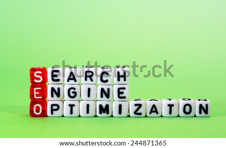 cubes with text ,SEO Search Engine Optimization on green - stock photo