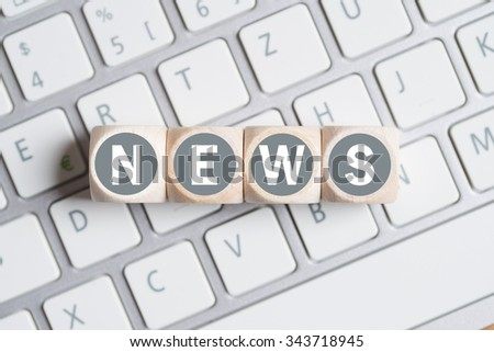 "cubes with the word ""news"" on a keyboard - stock photo"