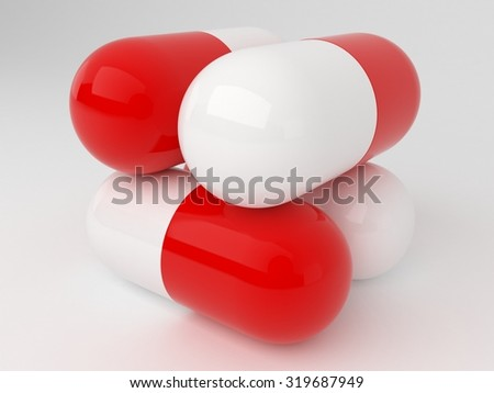 Cubic stack of four red white pills - stock photo