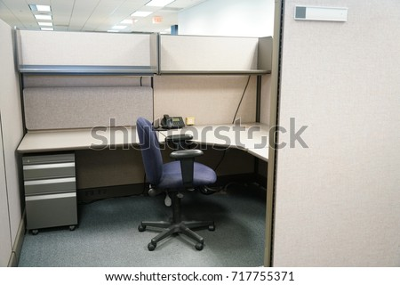 cubicle and office furniture in office room