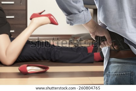 Cuckold. Flirting. Low section of business couple getting intimate on floor in office - stock photo