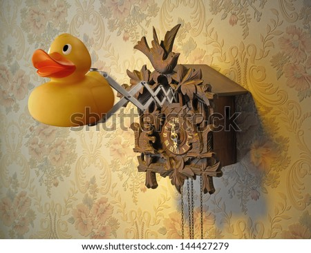 Cuckoo Clock and Rubber Duck - stock photo