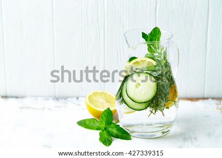 Cucumber and Lemon Detox Water - stock photo