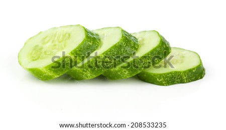Cucumber and slices isolated over white background - stock photo