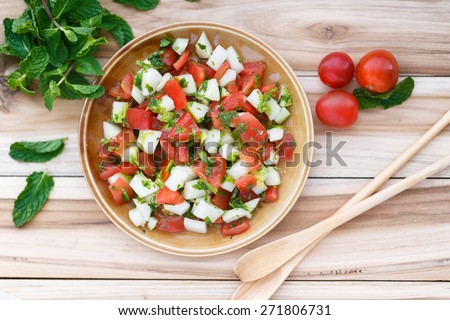 Cucumber and Tomato salad ( the Indian name is Ketchumbar) - stock photo