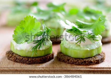 Cucumber and whipped with spring herbs feta cheese mini snacks seasoned with cilantro and dill - stock photo