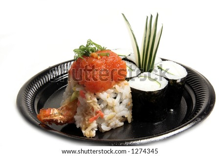 Cucumber Dragon Roll sushi roll with wasabi and pickled ginger and garnished with chopped chives - stock photo
