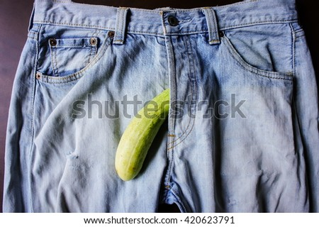 cucumber is the mark of penis in Jeans - stock photo